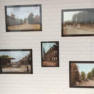 'Groeten uit Veghel' aan de muur bij boekhandel Schellen